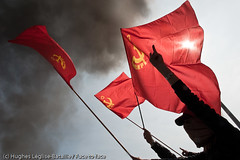 (Hughes Lglise-Bataille) Tags: red party sun france topf25 silhouette backlight turkey fire riot topf50 flag smoke communist strasbourg violence riots 2009 fra nato marxist kurd leninist otan meute mlkp