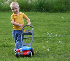 IMG_0566 (Tina  **~) Tags: boy grass yellow yard fun happy little jeans bubble blower dalto