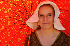 Marianne, stranger # 160 (Poupetta aka Ann) Tags: red woman smile hat parasol shade helsinkifinlandhelsingfors