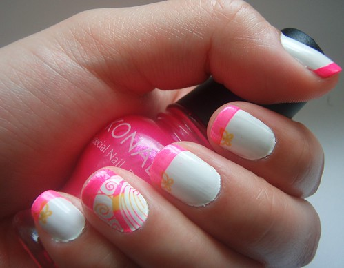 Konad pink swirl nail design