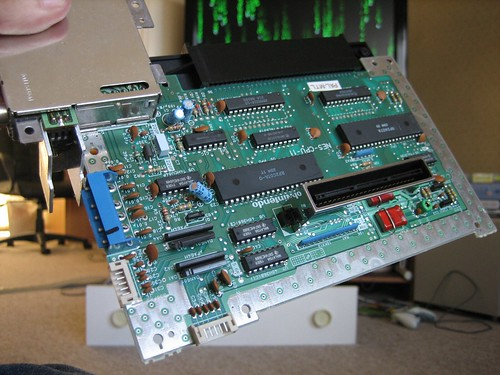 na acirc mystery pot on underside of nes motherboard to the right of the red parts in the bottom right corner or the board you will see a small round green pot you can stick a screwdriver in it and