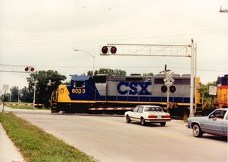 Northbound CSX Transportation Company freight train. Alsip Illinois. August 1990.
