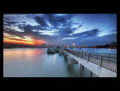 View from the Jetty (Ragstatic) Tags: city longexposure morning travel light sunset sea sky people sun seascape color reflection tourism beach water clouds sunrise relax landscape happy dawn photo google search nikon singapore rocks