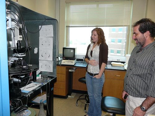 Hillary shows off her neuroscience lab to Alan Levine