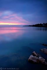 Beneath the Surface. (tsechel) Tags: morning ohio lake water sunrise rocks lakeerie shoreline greatlakes shore lorain 1740f4l loraincounty nothdr canon50d lakesidelanding 6nd 6gnd 9gnd