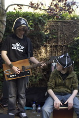 pirate buskers with a home-made-all-recycled guitar (.FuturePresent.) Tags: uk carnival christchurch england music sun sunshine festival spring theatre britain circus united performance culture kingdom dorset future present claudia local gabriela marques wimborne vieira milllane insectcircus riversmeet unit10 futurepresent claudiavieira claudiagabrielamarquesvieira festivalgen uniti0