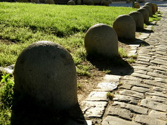 A Load of Old Bollards (Annie in Beziers) Tags: morning france grass sunshine cobblestones bollards walkingthedog bziers annieinbziers cathedralestnazaire