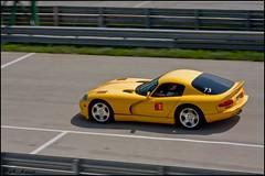 Viper in the Pit (Pat _ kono) Tags: motion green car yellow movement track wheels dodge pan viper panning fastcar