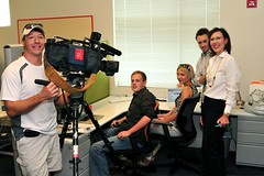 Interns, Sarah, Justin and Baptiste, camera man Casey and Karen  during news segment filming