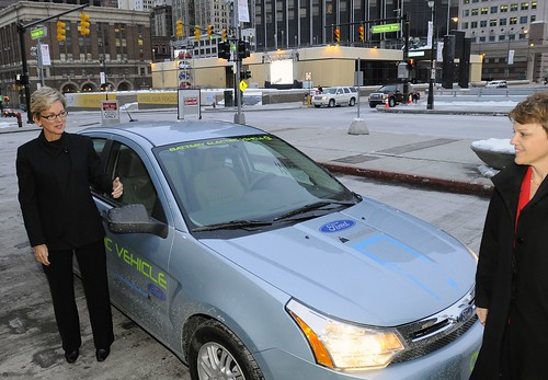 Gov. Granholm emerges from a hybrid car - Flickr