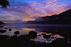 Sunrise in the lakes (redeyesatdawn) Tags: sky mist lake reflection film clouds sunrise nikon rocks fuji f100 velvia bliss ullswater iphotooriginal positve magicalskies