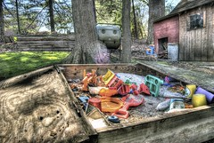 The old sandbox... (Dave DiCello) Tags: trees light shadow sun colors photoshop toys high sand nikon raw glare dynamic bright tripod shed flare nikkor range sandbox hdr exposures cs4 photomatix d40 tonemapped d40x evad310 davedicello