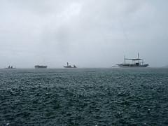"""Unos"" (enggul) Tags: sea storm rain dark boats drops gloomy cloudy olympus cebu raindrops unos waterproof malapascuaisland"