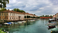 Peschiera, Lake Garda Italy (sminky_pinky100 (In and Out)) Tags: travel bridge flowers trees italy tourism water architecture river landscape boats town aqua europe cloudy scenic raining outlet lakegarda peschiera personalbest 5photosaday bej abigfave platinumphoto citrit eyejewel theperfectphotographer absolutelystunningscapes damniwishidtakenthat