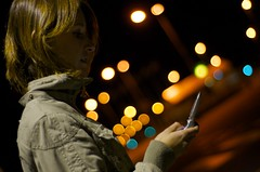 typing.. (Marcin Sowa) Tags: woman night 50mm nokia nikon dof message phone bokeh cellphone nightlight f2 nikkor typing iso1600 d300 krakoff