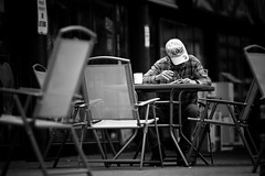 Slow Day (Dom Cruz) Tags: street people blackandwhite bw ontario canada man guy coffee canon reading newspaper spring cafe downtown dof candid guelph streetphotography smoking patio smoker f20 135l canonef135mmf2lusm 40d canoneos40d