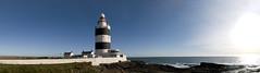 Hook Lighthouse panorama (Anna & Michal) Tags: ireland sea sky panorama sun lighthouse building tower nikon rocks europa europe ps stitching wexford d300 cs4 17055mm