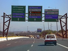 Sign posts above the Grande Raccordo Anulare near Rome, Italy (brooy) Tags: road city blue italy rome travelling green car horizontal italia driving sunny signpost mobility granderaccordoanulare directionpost