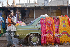 Cloth Market II (IreneAbdouPhotography) Tags: poverty man money men clothing commerce african markets poor business westafrica buy senegal dakar cloth tiedye sell profit economy income businesses batik africans microenterprise earn batiks microenterprises hlmmarket