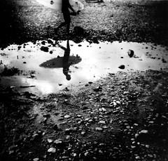 Banzai Beach (massi_pugliese) Tags: sea blackandwhite bw italy mer white black 120 6x6 film beach clouds square reflex surf italia nuvole mare waves kodak stones surfer grain surfing 66 bn pietre analogue sassi bianco blanc 200