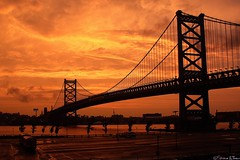 Sunset, After the Storm (Harpo42) Tags: bridge sunset sky orange storm philadelphia wet clouds dark pretty suspension dusk camden lot rainy philly benfranklin delawareriver