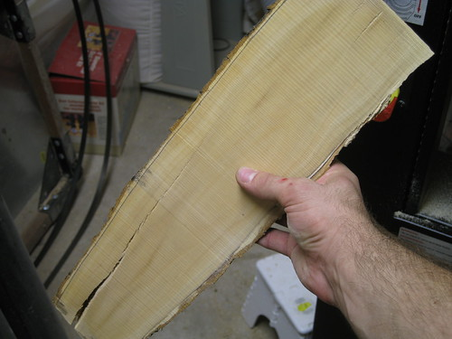 resawn board with raking light, showing rough cut lines