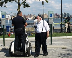 Police Officer on T-Motion Scooter, Hoboken NJ (jag9889) Tags: life street camera people car electric mobile frank drive newjersey automobile traffic control reporter nj police vessel scooter scene transportation cop segway vehicle hudsonriver 2009 department officer lawenforcement hoboken finest t1 sinatra standup hudsoncounty uscoastguard tmotion y2009 jag9889