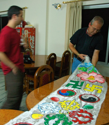 Ben and SteveD examine a Sakya style painted khatag the night before presentation, Tharlam Guesthouse dining room, Boudha, Kathmandu, Nepal by Wonderlane