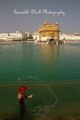 CRW_8830 (_saurabh_) Tags: boy india temple golden pond bath historical sikh punjab amritsar goldentemple punjabi waheguru harmandirsahib sarovar