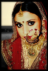 Indian bride (Pixychik) Tags: wedding portrait woman india girl beautiful canon bride marriage dressedup jewellery nosering aditi bejeweled 400d aditiswedding