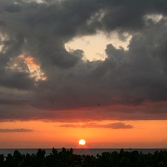 A dramatic sunset to kick-off an evening luau celebration.