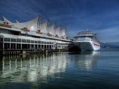 Carnival Splendor III (ecstaticist) Tags: ocean cruise sea sky sunlight holiday reflection water clouds canon dock exposure ship waterfront pacific bright salt sails vacouver terminal tourist massive multiple intersection tied visitor canadaplace hdr glassy behemoth rop reflction siling 3x traversal tonemapped tonemapping g10 147mp