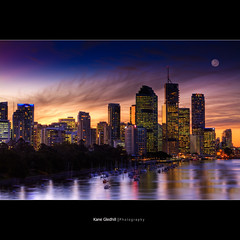 Just behind those buildings lies the oncoming zombie horde. ([ Kane ]) Tags: city light sky moon water clouds buildings reflections river boats lights glow cityscape dusk australia brisbane explore qld queensland kane frontpage hdr 2470 gledhill 50d alemdagqualityonlyclub kanegledhill grouptripod kanegledhillphotography