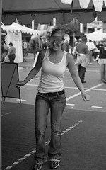 Beer Goggles (rfmueller) Tags: blackandwhite bw film beer girl drunk 35mm candid goggles northcarolina hc110 simulation raleigh jeans blonde analogue wifebeater nikonfe2 ncstatefair aristapremium400