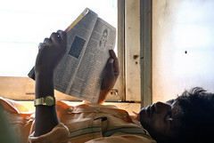 Indian man reading on a train (Pictures and Words) Tags: life travel friends people india man love train magazine fun living newspaper nikon indian read backpacking indie humans picturesandwords indie9999 stephenkeates wwwpicturesandwordscouk skuffpc