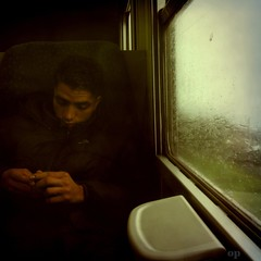 Rain and Cold (Osvaldo_Zoom) Tags: winter portrait cold window rain train hands journey commuter 500x500 winner500