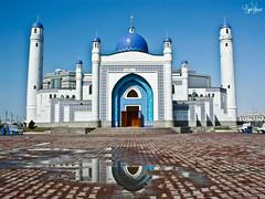 Mosque reflections (AgusValenz) Tags: door blue white blanco azul canon reflections rebel puerta muslim mosque mezquita kazakhstan reflejos xsi mesquita musulman atyrau explored kazajistan