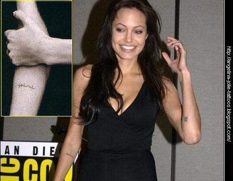 "Angelina Jolie tattoos. Arabic phrase ""???????"" (strength of will) This is"