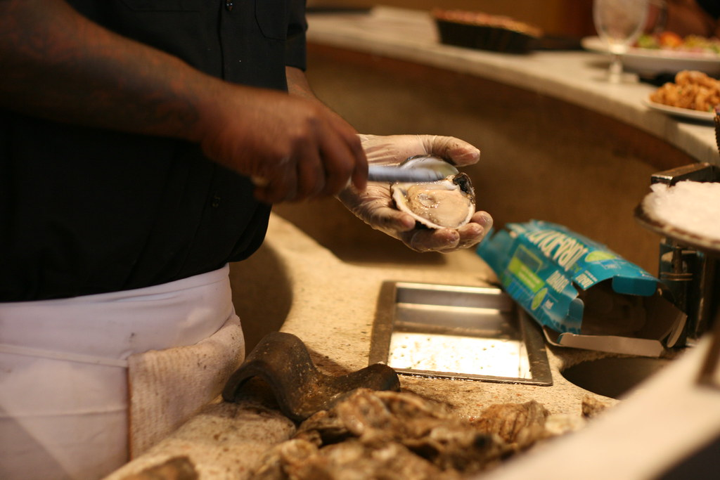 This guy was such a pro, he actually had an oyster shucking trophy.
