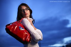 Girl with red purse (Konstantin Sutyagin) Tags: blue red sky woman girl beautiful beauty fashion bag asian glasses young handbag