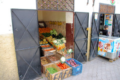 Moroccan Vendors (cwgoodroe) Tags: tangier tanger morocco moroccan africa ferry plane bus doorway arab muslim mosque merchant street arabic metaldoors colors summer streetlife vibrant poor kasbah casbah casbha ancient moors christians fishmerchant artistic ocean city sea sand sun panasonic pentax continent people script merchants children metal doors colorful conservative fish monger cafe friendly vegtable old cleric casba dailylifeportrait sadfaces