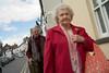 Red coat Lady (debfreemansmudge) Tags: wales shopping abergavenny streetshooting leicam8 hayonwyebookfestivalweek ladyinaredcoat clockedattheback