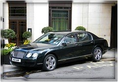 Black Bentley @ The beautiful Dorchester Hotel in London / Mayfair, England / United Kingdom. One of the most recognized and luxurious hotels on the planet. Enjoy!:) (|| UggBoyUggGirl || PHOTO || WORLD || TRAVEL ||) Tags: uk ireland england horse black london english love breakfast facade photography hotel asia europe unitedkingdom middleeast limo tourists worldwide enjoy hydepark visitors mayfair fareast polo limousine dorchester bentley aerlingus luxurycar thepromenade bmi sayyes urbansetting boyracer horsestatue 4door cityjet luxuryhotel heritagehouse travelaroundtheworld grandhotels irishlove nowandforever irishpride sultanofbrunei happy2010 irishluck classicalhotel girlchaser grandarchitecture may2010 greathotelsoftheworld grandtraditions smilesahead luxuryracer gentlemancar heartofthecapital classicsetting hospitalitylegend thedorchesterhotellondon oneofthebesthotelsontheplanet dorchestercollectionflagship alwaystravelaroundtheglobe