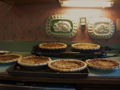 6 derby pies sitting on the counter to cool