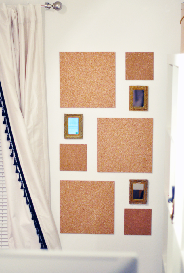 cork wall tiles with small gold framed mirrors