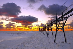 South Haven Perspective (PhotoDocGVSU) Tags: winter sunset lighthouse snow ice colors lakemichigan greatlakes southhavenmi aplusphoto january2009