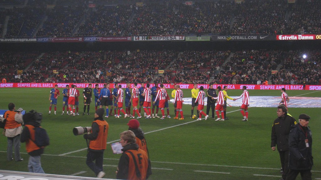The players from FC Barcelona and Atletico Madrid shake hands before the match at Camp Nou, in Barcelona.