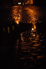 (sulch(not around much at the mo)) Tags: orange reflection rain night puddle lights scotland edinburgh cobbles
