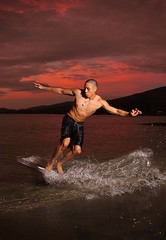 Swoosh (Bernie Led) Tags: sunset red sea sky man beach water sand outdoor board flash skim skimming strobes strobist