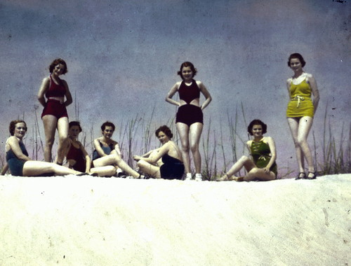 Young women posing in swimsuits on sand dune